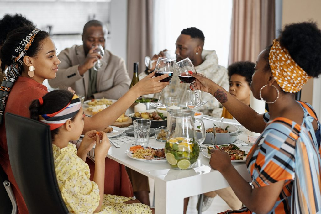 Couple gathering at dinner with family