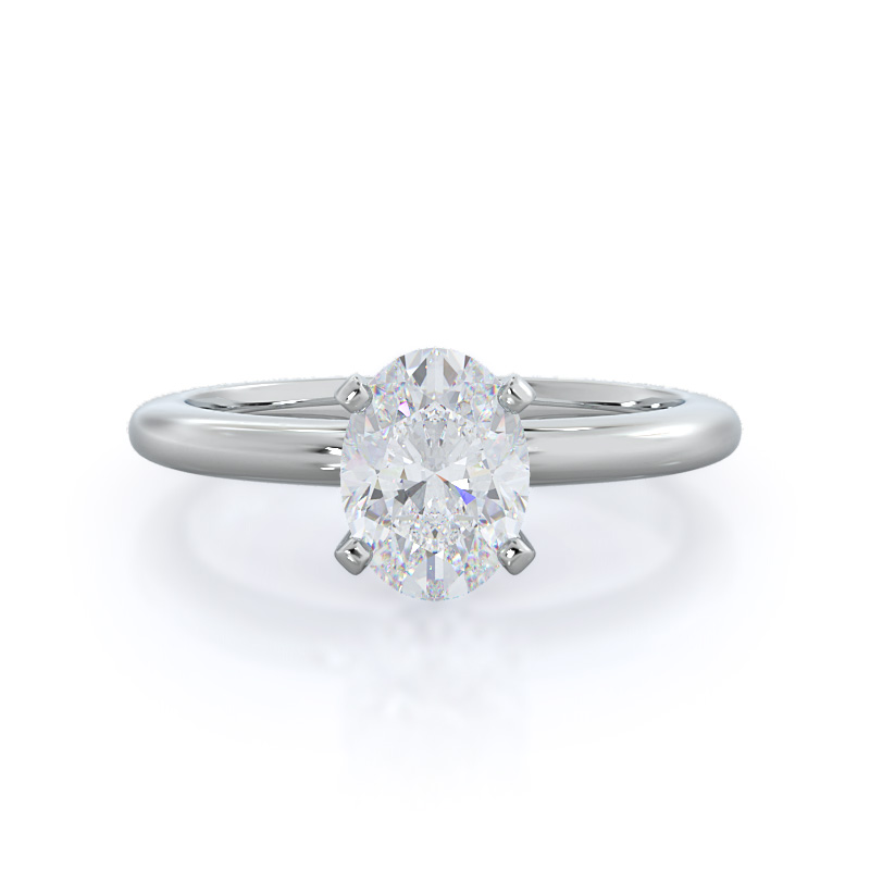 Classic four prong solitaire oval diamond engagement ring; in white gold: front view