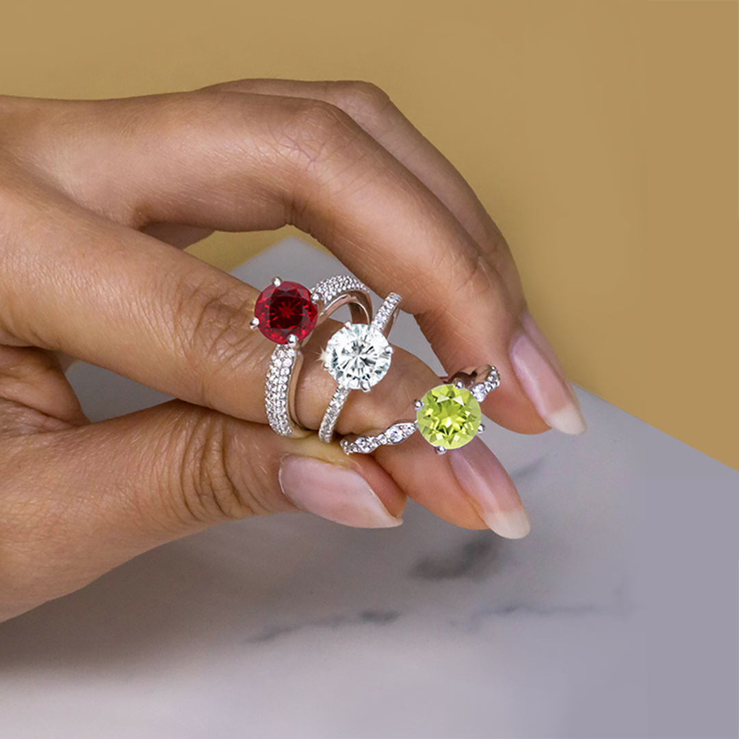 alternative engagement rings: ruby ring, moissanite ring, peridot ring