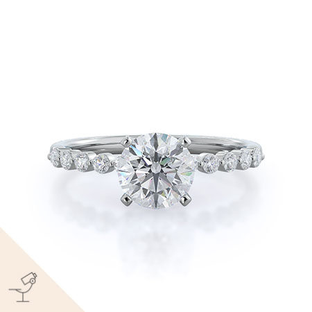 Under bezeled accent diamond engagement ring