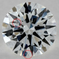 diamond with a zoomed in crystal inclusion