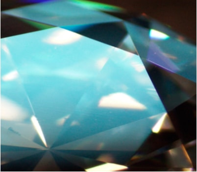 light reflecting off the surface of the diamond