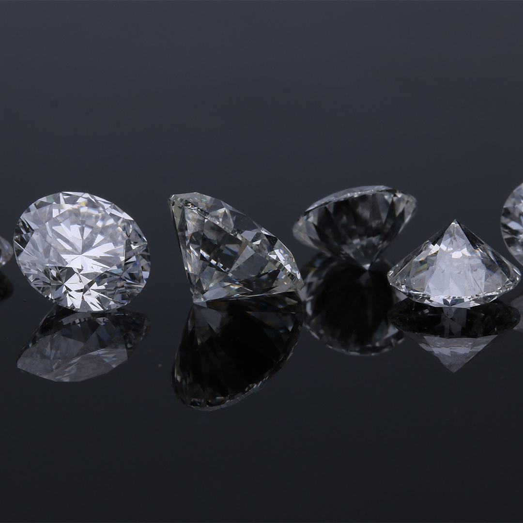 Four white loose lab diamonds
