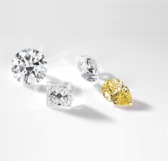 different shaped brilliant diamonds sparkling on a surface