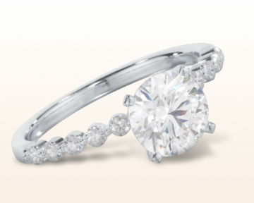 round engagement rings Under Bezeled Accent Diamond