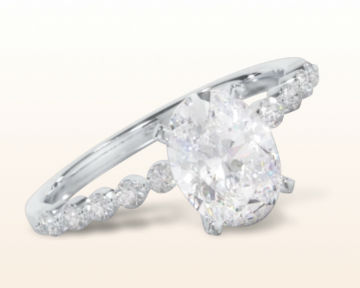 oval engagement rings Under Bezeled Accent Diamond