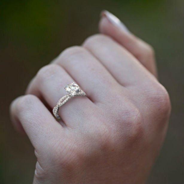 infinity engagement rings woman's hand