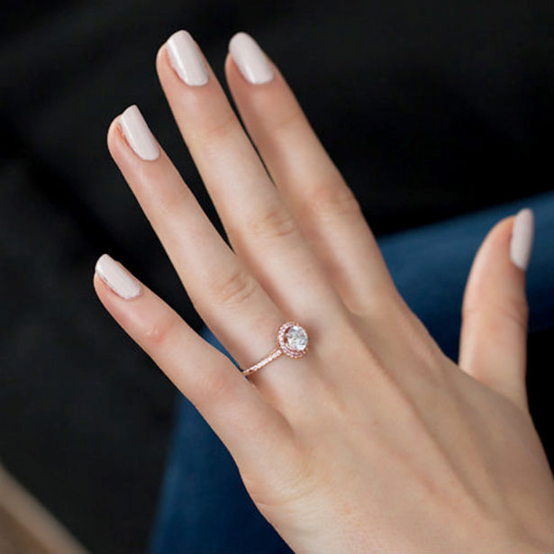 women's rose gold engagement rings woman with ring on