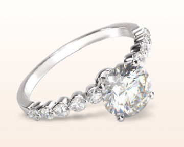 pave engagement rings under bezeled accent diamond