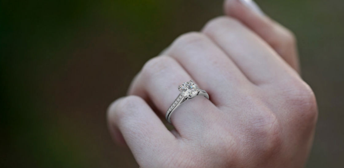 pave engagement rings woman's hand