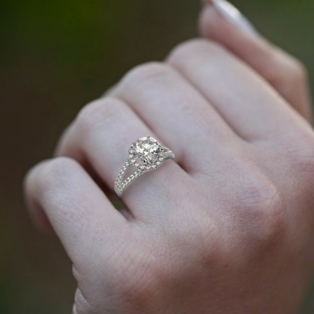 split shank halo engagement ring woman's hand