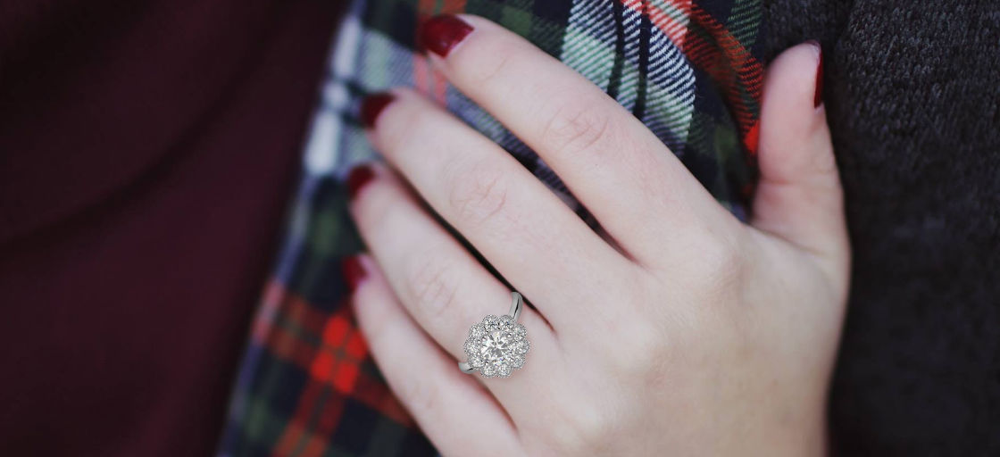 woman wearing unique halo engagement ring