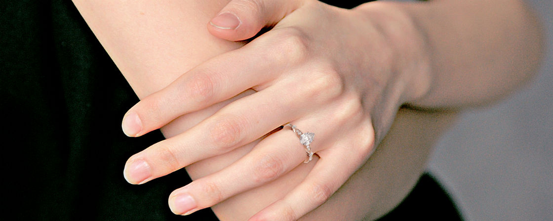 rose gold pear shaped engagement rings woman's hand