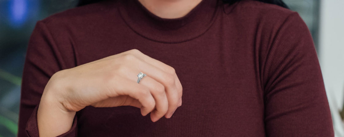 woman's hand wearing bypass engagement ring