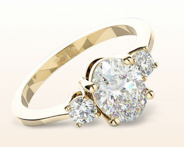 yellow gold oval engagement rings petite three stone