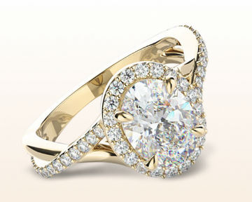 yellow gold oval engagement rings swaying split shank halo