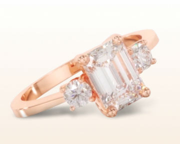 rose gold emerald cut engagement rings petite three stone diamond