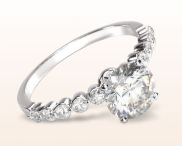 simple engagement rings under bezeled accent