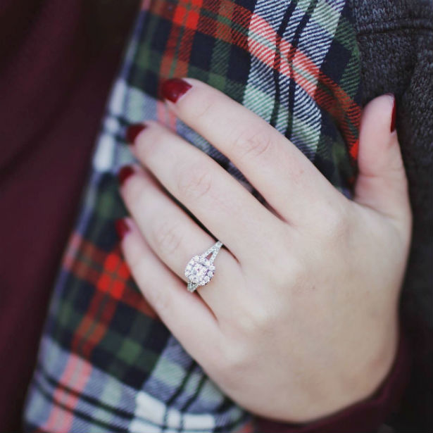 woman's hand wearing split shank engagement ring