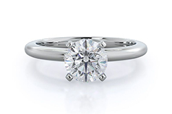 single diamond solitaire ring in white gold