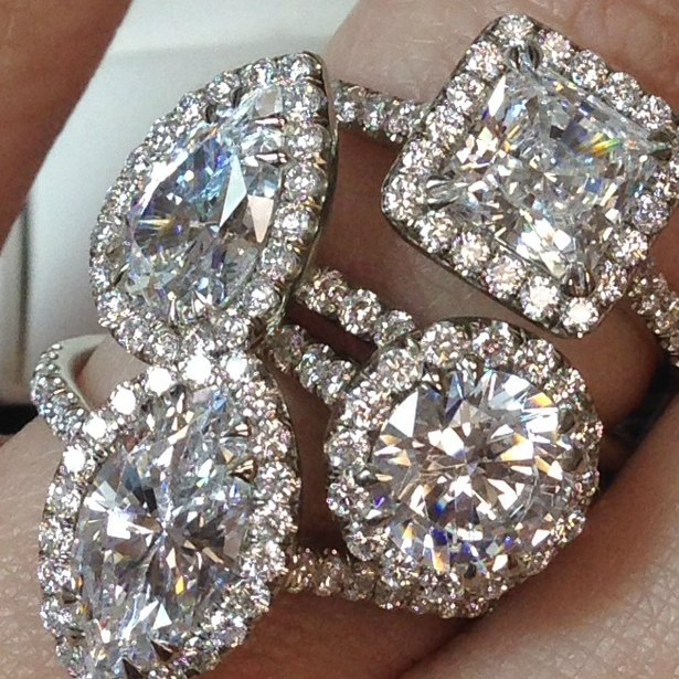 four diamond halo engagement rings in round princess cushion pear shapes