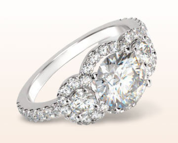 halo engagement ring with three stones