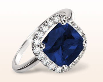 halo engagement ring with sapphire