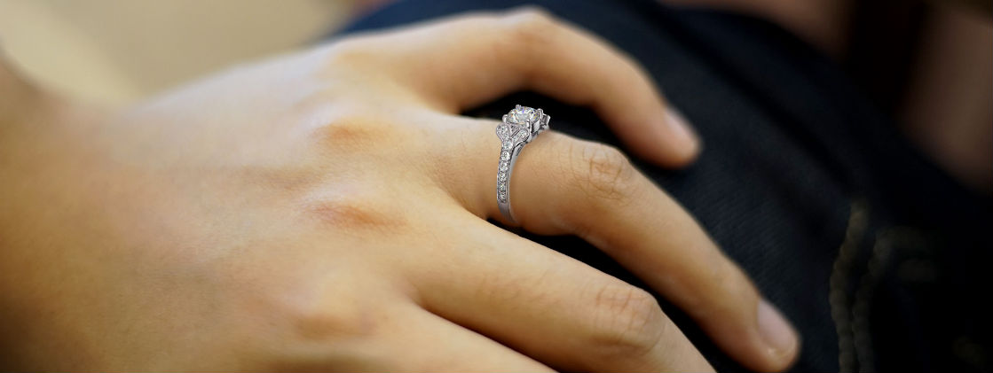 low profile engagement rings woman's hand