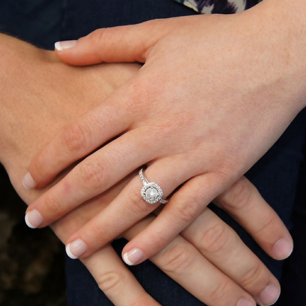cushion halo ring and couple's hands