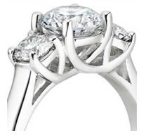 prong set accent diamonds off setting the center in a three stone style