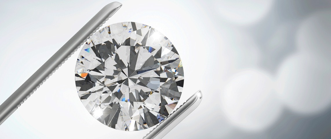 diamond held by tweezer examined under magnification
