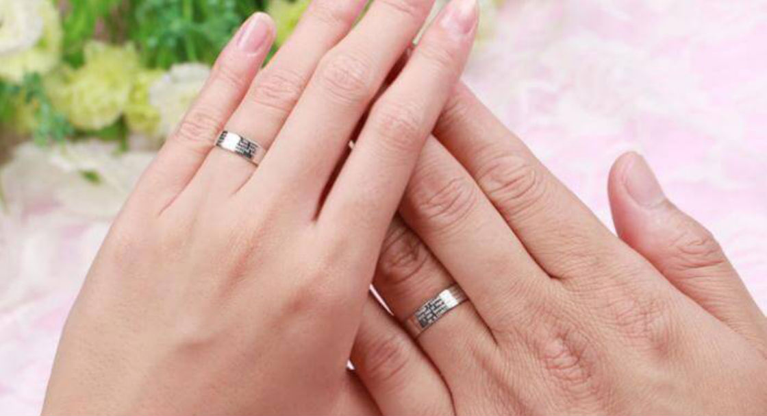 platinum ring bands couples hands