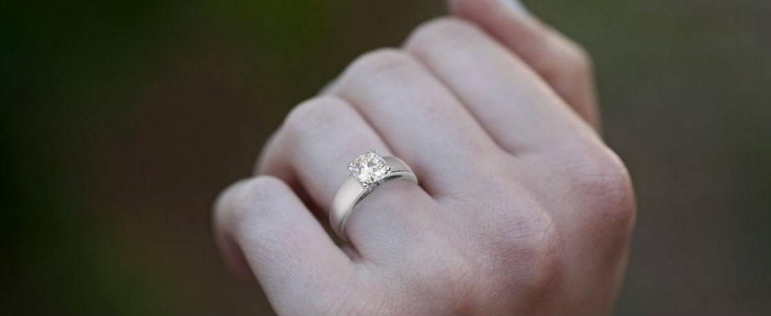 wide band engagement rings woman's hand