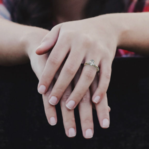 woman wearing baguette diamond engagement ring