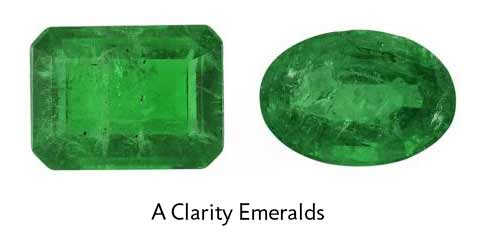octagon and oval emeralds with noticeable eye visible inclusions that affect the depth of color