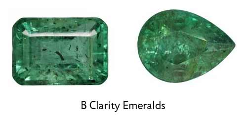 octagon and pear emeralds with larger, obvious eye visible inclusions that look opaque