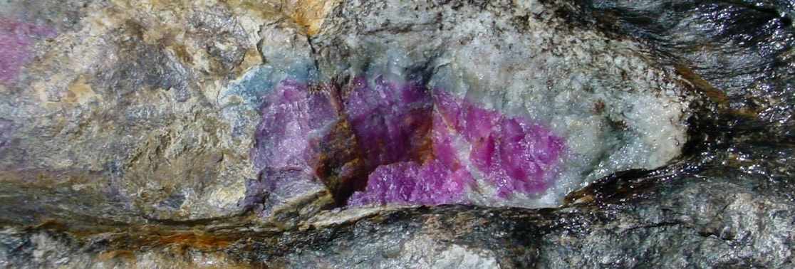 ruby forming in rough rock formations