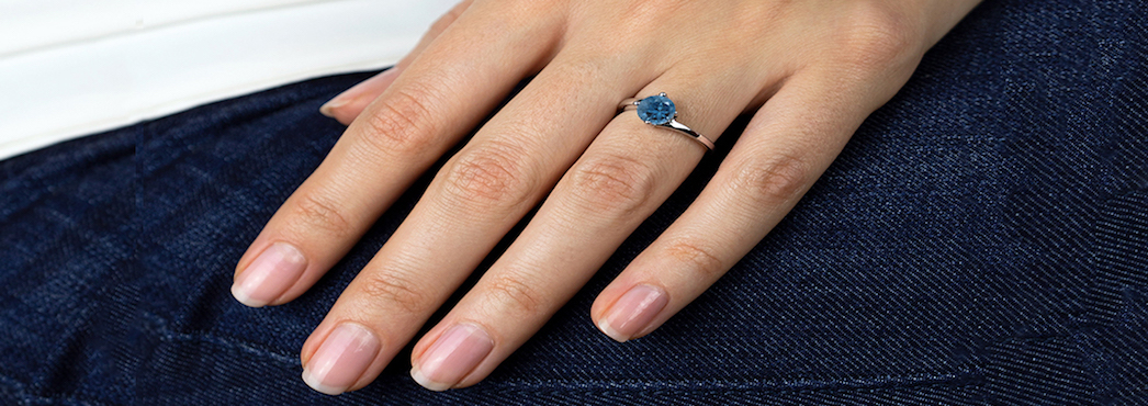London Blue topaz solitaire ring on hand