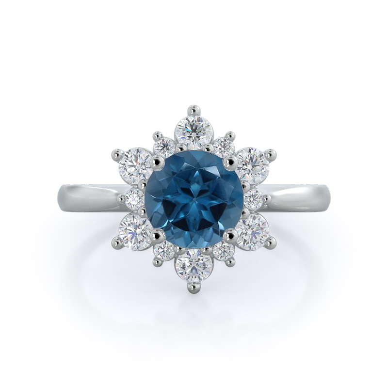 https://www.withclarity.com/gemstone-rings/shop-gemstone-rings/metal/14kt-white-gold/carat/0.50/star-halo-london-blue-topaz-ring-round-london-blue-topaz