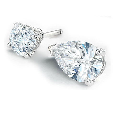 pair of round and pear shaped diamond earrings