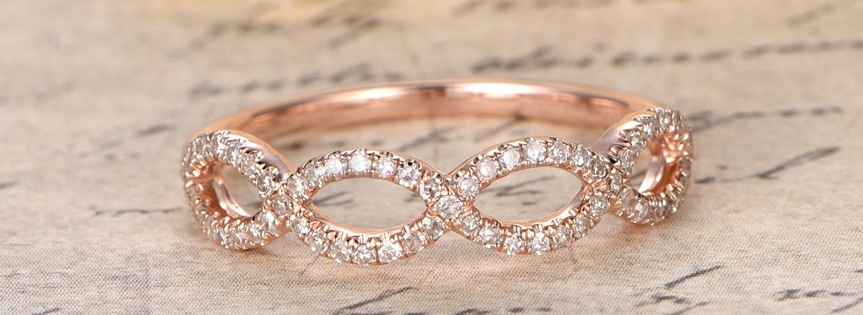 on trend rose gold and diamond twisting band