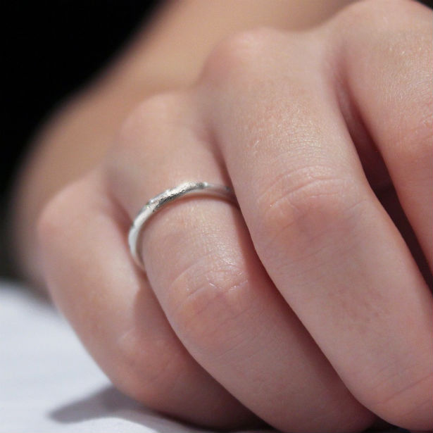 platinum patina woman's hand with ring on